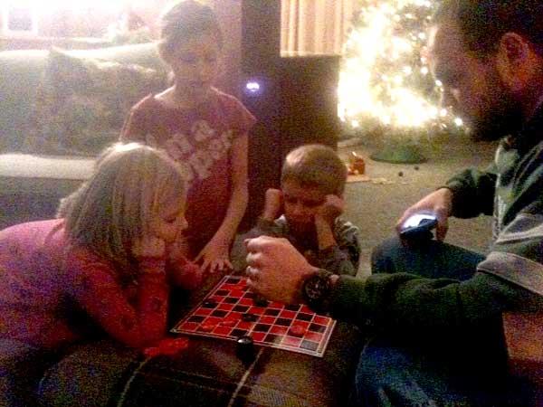 Dad vs. kids checker tournament