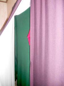 Blankets are hung under curtains to provide extra insulation during the winter.
